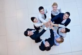 18175760-business-people-group-joining-hands-and-stay-as-team-in-circle-and-representing-concept-of-friendshi